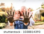 Senior Man With Granddaughter...