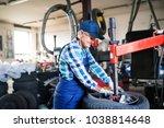 senior female mechanic... | Shutterstock . vector #1038814648