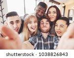 selfie of young smiling people... | Shutterstock . vector #1038826843