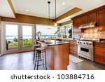Stock photo luxury kitchen interior with green walls and stone floor and water view 103884716
