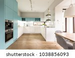 Stock photo blue and white cabinets in modern kitchen interior with wooden floor 1038856093