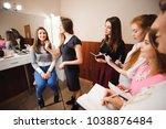 makeup teacher with her student ... | Shutterstock . vector #1038876484