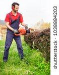 professional gardener dressed... | Shutterstock . vector #1038884203