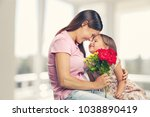 happy daughter and mother | Shutterstock . vector #1038890419