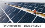 solar power station workers | Shutterstock . vector #1038891529