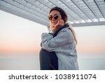 girl in sunglasses wearing coat ... | Shutterstock . vector #1038911074