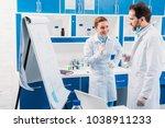 scientist in white coats near... | Shutterstock . vector #1038911233