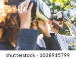 woman and man wearing virtual... | Shutterstock . vector #1038915799