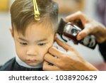 hairdresser's hands making... | Shutterstock . vector #1038920629