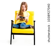 pretty teen girl sitting ... | Shutterstock . vector #1038927040