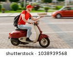 deliveryman driving through the ... | Shutterstock . vector #1038939568