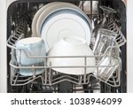 dishes in the basket of a... | Shutterstock . vector #1038946099