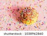 doughnut with yellow icing and... | Shutterstock . vector #1038962860