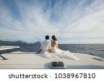 wedding couple is hugging on a... | Shutterstock . vector #1038967810