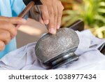 an artisan  is decorating the... | Shutterstock . vector #1038977434