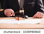 close up of male lawyer or... | Shutterstock . vector #1038980860