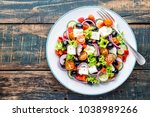 greek salad of fresh cucumber ... | Shutterstock . vector #1038989266