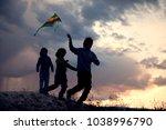 children playing kite on summer ... | Shutterstock . vector #1038996790