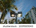 high rise condominium at dusk... | Shutterstock . vector #1039005043