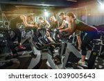 group of fit women and men... | Shutterstock . vector #1039005643