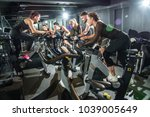 sporty people riding indoor... | Shutterstock . vector #1039005649