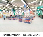abstract blurred supermarket... | Shutterstock . vector #1039027828