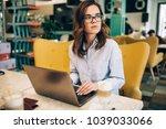 business meeting in cafe | Shutterstock . vector #1039033066