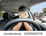 young man closed his face with... | Shutterstock . vector #1039040578