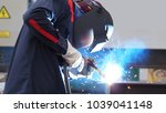 welding with sparks by process... | Shutterstock . vector #1039041148