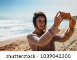 hipster young girl photograph... | Shutterstock . vector #1039042300