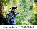 woman with binoculars and... | Shutterstock . vector #1039058449