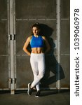 fit young woman taking a urban... | Shutterstock . vector #1039060978