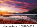fantastic sunset over the... | Shutterstock . vector #1039064293