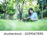 beautiful woman writing into... | Shutterstock . vector #1039067890