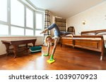 housewife acrobat does tricks... | Shutterstock . vector #1039070923