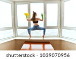 woman washes windows in a yoga... | Shutterstock . vector #1039070956