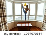 female athlete washes windows ... | Shutterstock . vector #1039070959