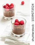 chocolate dessert in glasses...   Shutterstock . vector #1039073524