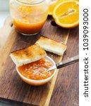 orange jam in bowl with toast...   Shutterstock . vector #1039093000