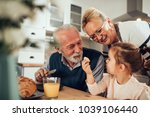 grandparents having breakfast... | Shutterstock . vector #1039106440