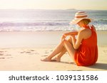 beautiful young woman relaxing... | Shutterstock . vector #1039131586