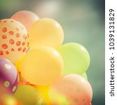 many colorful baloons in the... | Shutterstock . vector #1039131829
