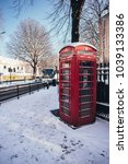 Phone Booth In Snow. London