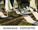 view of many sunbeds and closed ...   Shutterstock . vector #1039140700