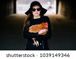 Stock photo young elegant brunette fashionable model girl in sunglasses holding chiken in hands stylish female 1039149346