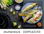 Stock photo mediterranean food smoked herring fish served with green onion lemon spices cherry tomatoes bread 1039162153