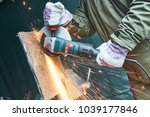 worker grinding cutting metal... | Shutterstock . vector #1039177846