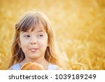 child and bread. selective... | Shutterstock . vector #1039189249