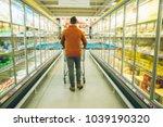 man walk with cart between rows ...   Shutterstock . vector #1039190320