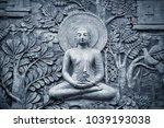 buddha wooden carving | Shutterstock . vector #1039193038